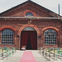 newport ralway sheds vintage carnival red carpet aisle runner jawa chairs old luggage suitcases wedding planner melbourne geelong surf coast